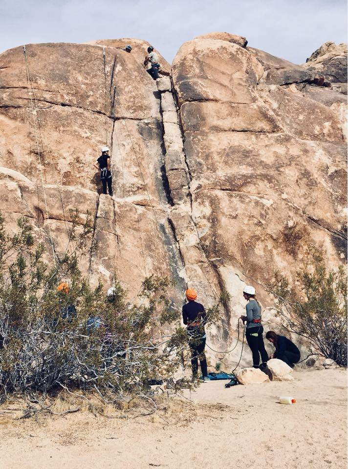 Group of students rock climbing in Joshua Tree National Park; 2017.